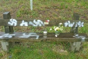 A commemorative bench which has been spray painted with a swastika in Twyford Woods, Lincolnshire, a site which was used as an airfield in the Second World War for aircraft to take off for Normandy ahead of D-Day. Picture: Lincolnshire Police/PA Wire