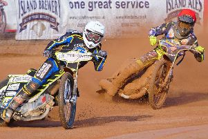 Ben Wilson scorches ahead of Georgie Wood. Speedway. Isle of Wight Wightlink Warriors v Plymouth Gladiators. Picture: Ian Groves/Sportography