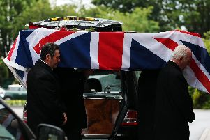 Col Dockerill's coffin is borne into the chapel. Funeral of Col Geoffrey Dockerill at Portchester Crematorium.            Picture: Chris Moorhouse           (120619-30)