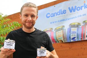 Jake Davies with his Portsmouth Candle, which smells like 'fresh linen and sea breeze'