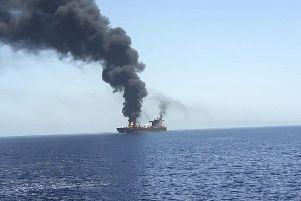 In this photo released by state-run IRIB News Agency, an oil tanker is on fire in the sea of Oman. Picture: (IRIB News Agency via AP)