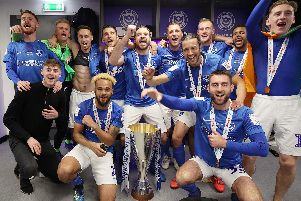 The Pompey players celebrate their Checkatrade Trophy final victory over Sunderland Picture: Joe Pepler