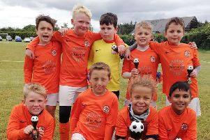 The Under 9s Tigers with their trophy