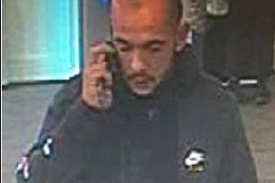 CCTV of a man police want to speak to in connection with a scam in Fareham.