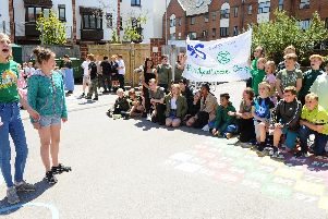 (left and right) Anna Douglas (14) and Amelia Cox (13) lead the protest.''Picture: Sarah Standing (210619-1419)