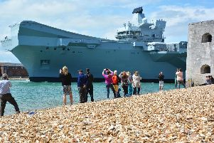 HMS Queen Elizabeth as she sailed out of Portsmouth. Picture: Ben Mitchell/PA Wire