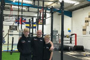 Daz Dugan stands proud at opening of gym with sons Troy and Neo Dugan