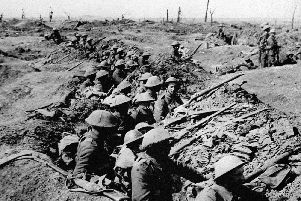 British infantrymen occupying a shallow trench before an advance during the Battle of the Somme. Picture: PA