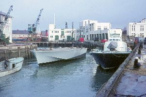 On the right is the fast patrol vessel Ferocity with wood stock hull being towed in alongside. Picture: Graham Stevens