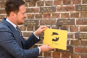 Stephen Morgan, MP unveils the brick to grandfather, James Kaminski.''Picture: Keith Woodland (060719-22)