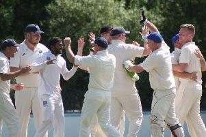 Glendermott players celebrate after taking another wicket against Ballyspallen.