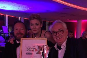 Andrew and Robert Pearce, owners of Creatiques Bridal Boutique, Southsea, with Kayleigh Middleton, assistant manager receiving a previous award.