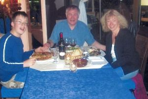 Happy families: Iain Shepherd, centre, pictured with his wife Mary and his stepson, Joshua in 2009. By this point he had almost stolen 58,000 of his Joshua's inheritance left to him by his late father.