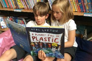 Children reading Neal Layton's new book, A Planet Full of Plastic.