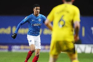 Louis Dennis - seen here against Oxford in his sole league outing for Pompey - has earned praise from Brett Pitman following Pompey's 11-0 win over UCD. Picture: Joe Pepler