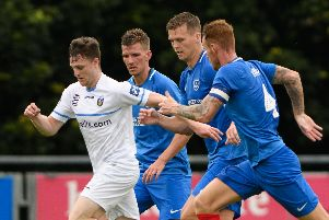 Sean Raggett, centre right, in action for Pompey against UCD   Picture: Arnold Byrne
