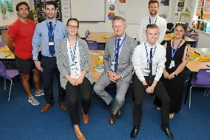St Edmund's Catholic School in Portsmouth, has seven teachers and three support staff at the school which are ex pupils. (back l-r) Adam Poxton, head of PE, Jason Brown, head of Year 11, Joe Were, head of English and Jackie Robinson, data and assessment manager, with (front l-r) Jovanna Tuffnell, English teacher, Chris Nicol, R.E teacher and Leon Miller, teaching assistant. Three additional members of staff are not in the photograph due to absence or teaching commitments. Picture: Sarah Standing (110719-)