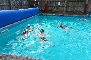 Daniel Jones, Oliver Meadows, Anna Keefe and Aidan Leonard enjoy a swimming lesson at their school pool.