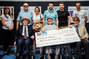The Draper family presents a cheque for �10,000 to Care for Veterans