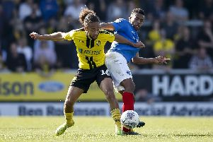 Marcus Harness battles Nathan Thompson for the ball during Pompey's win at Burton in April. Picture: Daniel Chesterton/phcimages.com
