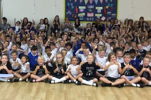 Pupils of Thomas A Becket Infant School celebrating their Ofsted result SUS-190723-081650001
