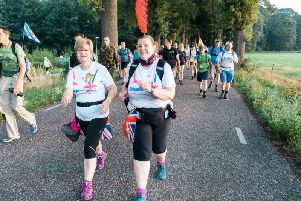 Pat (left) walked 100 miles in four days