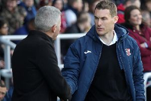 Lock horns: Keith Curle with Exeter boss Matt Taylor.