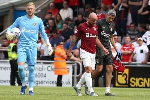 Alan McCormack limps off the pitch. Picture: Pete Norton