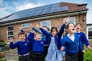 Children at  Chichester's Lancastrian Infants School celebrate their new solar panels provided by Portsmouth City Council through a partnership with West Sussex County Council. Photo: Darren Cool