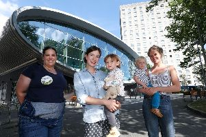 Debutots leader Jo Bennington, left, with Ellen Macdonald and Annie, two, and  Amy Williams, right, with Milo, two, pictured at  Somerstown Community Hub, Portsmouth.      Picture: Chris Moorhouse     (020819-15)