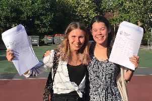 Katie O'Flaherty, left, and Pippa Noble, right, collect their results at Portsmouth Grammar School