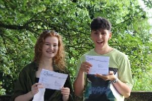 Heathfield Community College students Louisa Dollimore and George Hodges with their results