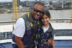 Tiana Rato, right, with her father Vernon at the top of the O2 Arena in London. Picture: Naomi House and Jacksplace
