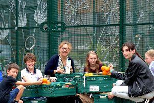 Portsmouth City Council's cabinet member for education, Councillor Suzy Horton (centre), with children at Somerstown Adventure Playground.