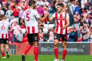 Luke O'Nien celebrates with Alim Ozturk at the final whistle