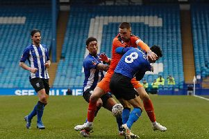 Sonny Bradley battles for the ball during Town's 0-0 draw at Sheffield Wednesday last season