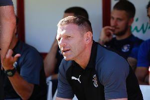 Luton boss Graeme Jones at Oakwell this afternoon