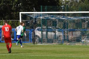 Callum Saunders' penalty hits the back of the net.