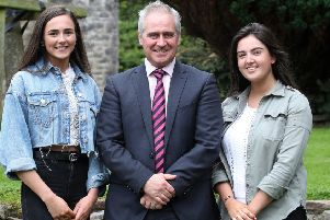 Anna Ewings and Sienna Taggart who both gained an incredible 10 A* grades in their GCSEs are congratulated by principal Jonny Brady.