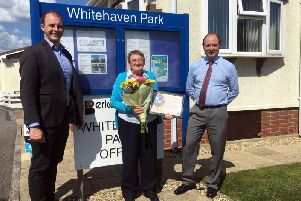 Matt Warman MP (left) with awarded manager Sharon Ellis and Berkeleyparks MD David Curson