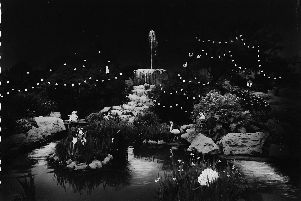 The wonderful Rock Gardens fountain, Southsea, lit up at night.