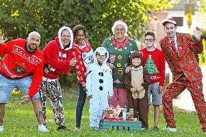 Help us to help those who are less fortunate at Christmas - say the organisers of the Leigh Park PO9 Foodbank. (left to right) Darren McKenna, Charlie Lawrence, Addieson Lawrence (11), Millie-Mai Rose (7), Michelle Smith, Maila-Marie Rose (6), Marshall Henson (10) and Marc Maran ''Picture: Malcolm Wells (190829-6938)