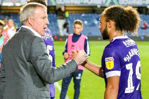 Pompey boss Kenny Jackett congratulates Marcus Harness after the win at QPR. Picture: Nigel Keene