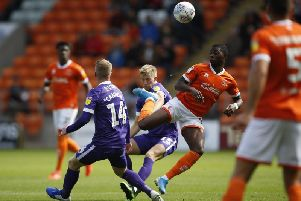 Ross McCrorie and Andy Cannon in the thick of it for Pompey at Blackpool / Picture by Paul Thompson