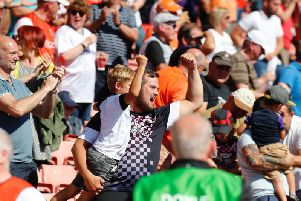Hatters fans celebrate a victory at Barnsley recently