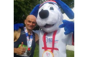 Simon Perkin with his silver medal and a mascot from the World Transplant Games. Photo supplied.
