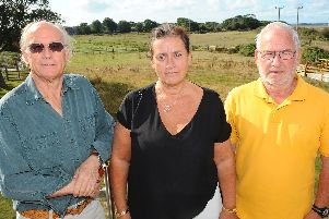 Residents Richard Platt, 74, Eleanor Newman, 52, and Ray Rowsell, 74, overlooking the proposed caravan park site from Eleanor's house. Picture: Sarah Standing