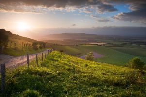 Stunning landscape at sunset over rolling English countryside SUS-190609-121906001