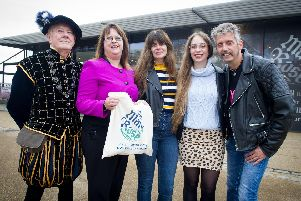 Pictured : Bob Meredith dressed as Vice Admiral Sir George Carew with chief executive Helen Bonsor-Wilton presenting visitors, Sue Pope, her daughter Rosanna and Sue's husband, Colin Pope with a gift bag outside the Mary Rose Museum, Portsmouth.''Picture : Habibur Rahman