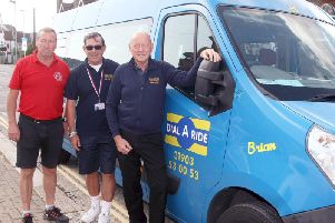 Dial-a-Ride bus renamed in honour of Brian Ingham, driver who died of a stroke. From left, Mark Hooper (from A-Z signs), driver Stuart Cooper and Gary Mills, manager. Photo by Derek Martin Photography.